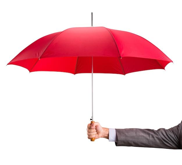 Рука с красным зонтиком