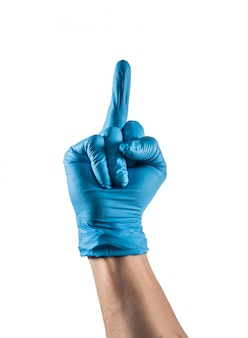 Hand with blue latex glove showing the middle finger