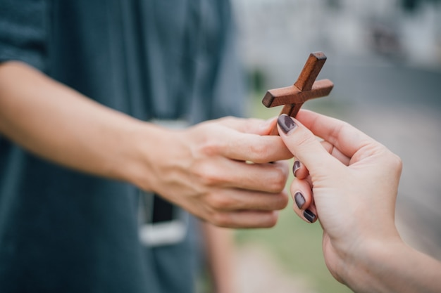 Hand with cross .concept of hope, faith, christianity, religion, church online.