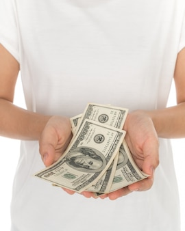 Рука с долларами на белом фоне