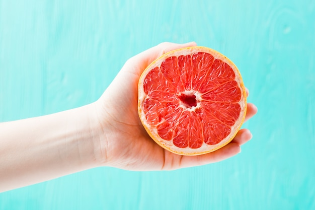 Hand with fresh grapefruit