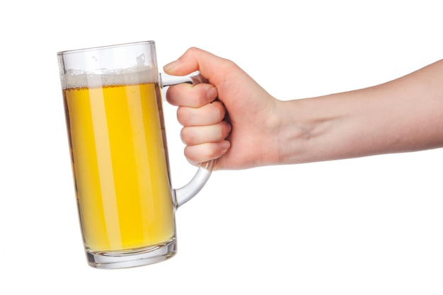 Hand with full beer glass isolated on white