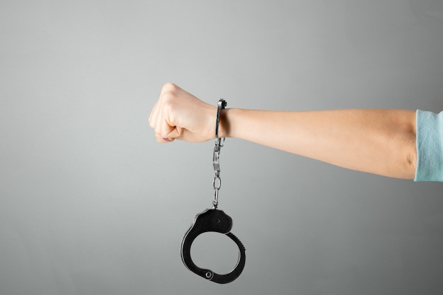 Hand with handcuff