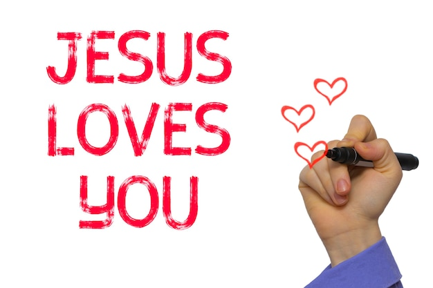 イエスがあなたを愛しているという言葉を書いているマーカーの手