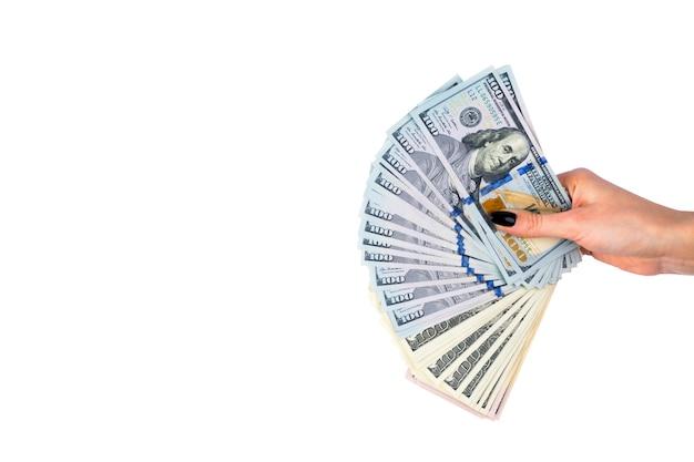 白い背景で隔離のお金で手。手元に米ドル。一握りのお金。