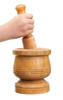 Hand with pestle and mortar