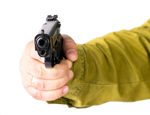 Hand with pistol isolated on white