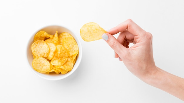 Hand with potato chips