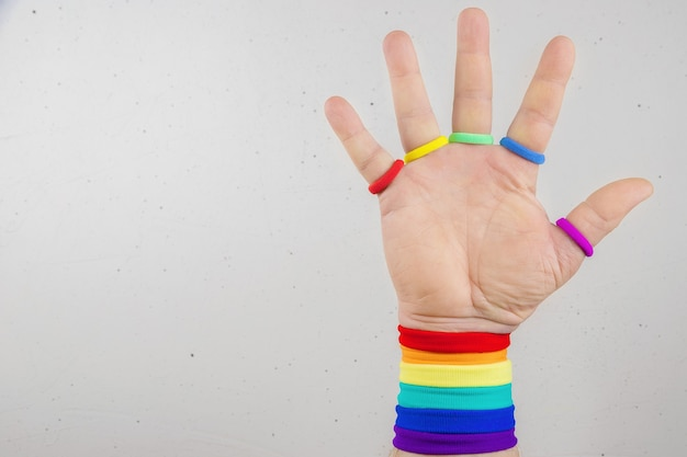Hand with rainbow colored armbands lgbt theme