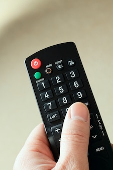 Hand with a remote in front