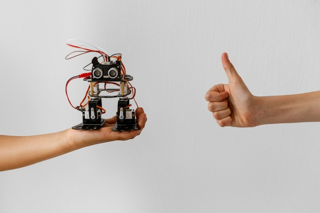 Hand with robot and ok sign