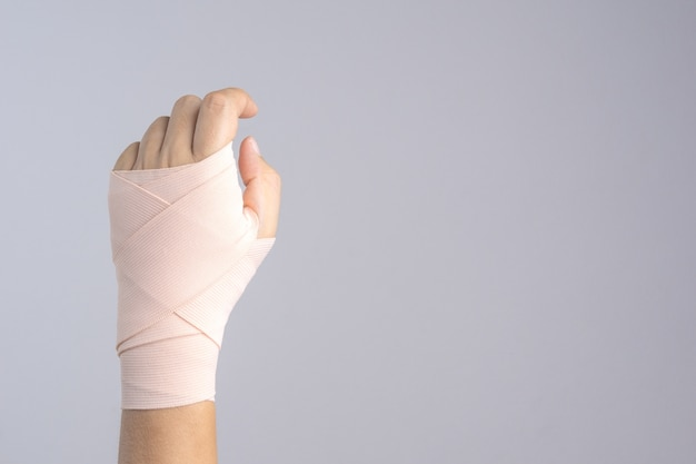 Hand with strapped bandage
