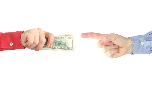 The hand with the writing pen reaches for the hand with the money. payment for work.