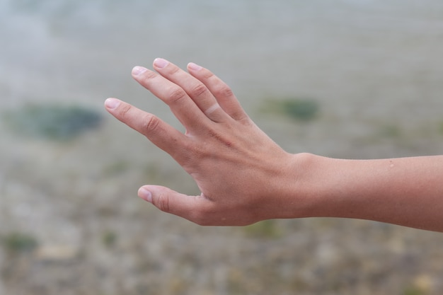 Hand without engagement ring with suntan.