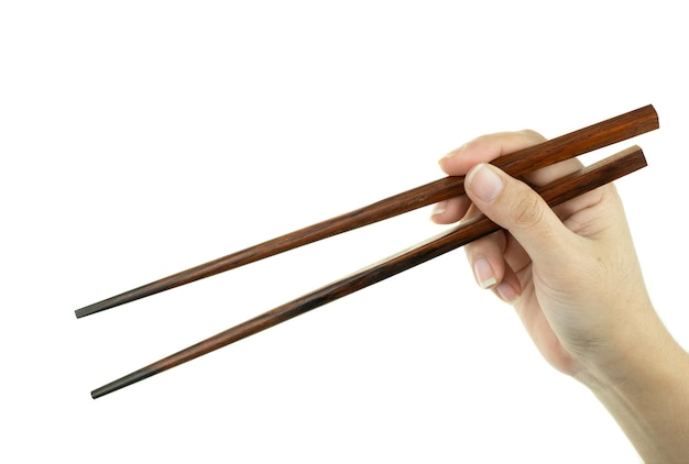 Hand woman holding wooden chopsticks handmade by rosewood on white