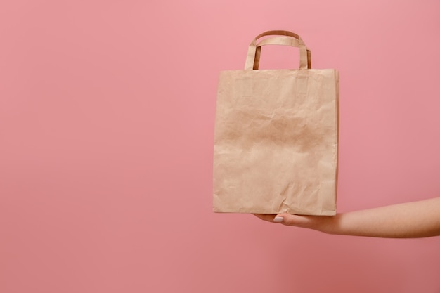 In hand of woman paper bag