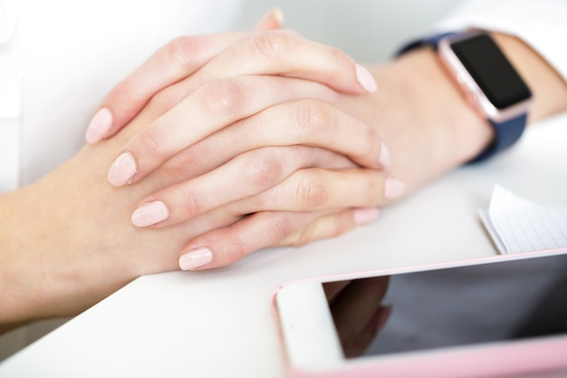 Hand of woman with   smartwatch  in  office