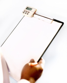 Hand writing on blank paper of black plastic clipboard