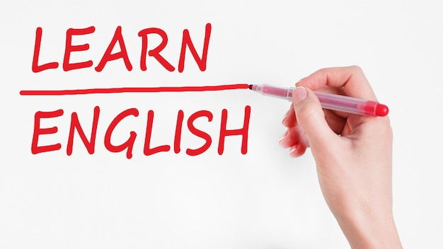 Hand writing inscription learn english with red color marker, concept, stock image