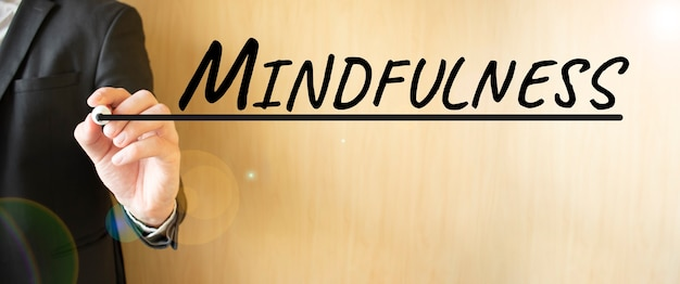 Hand writing inscription mindfulness, with marker,business concept