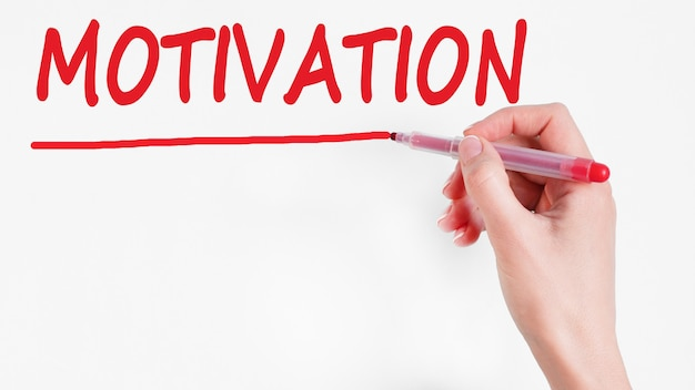 Hand writing inscription motivation with red color marker, concept, stock image