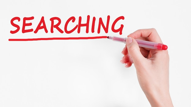Hand writing inscription searching with red color marker, concept, stock image