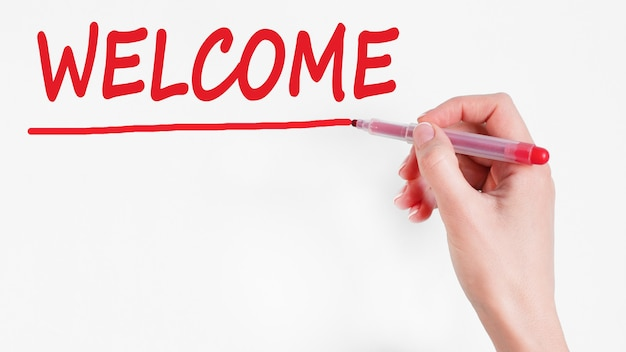 Hand writing inscription welcome with red color marker, concept,