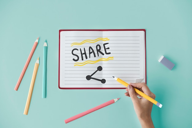 Hand writing share on a notebook