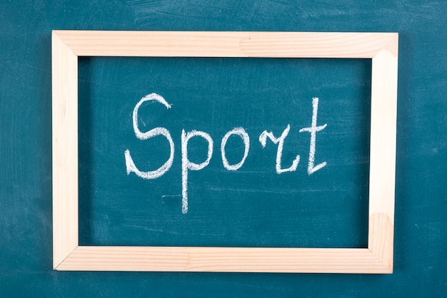 Hand written sport word on blackboard
