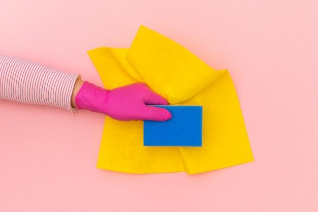 手黄色保護ピンクグローブ手ぼろワイパー背景青