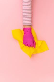 手黄色保護ピンクグローブ手ぼろワイパー背景