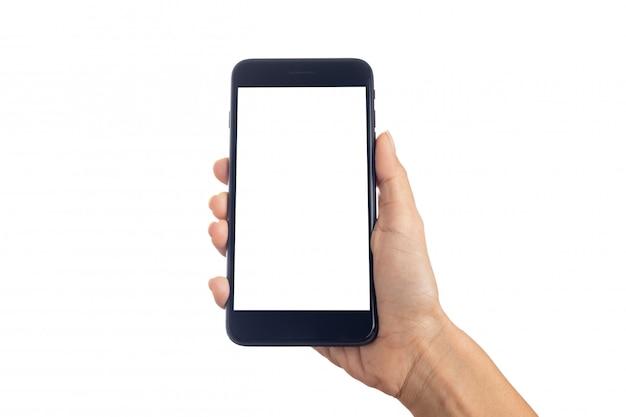 クリッピングパスと白い背景で隔離された空白の画面を持つモバイルのスマートフォンを保持している手若い女性