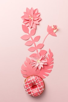 Handcraft plant corner from live colar paper with tropical leaf and donut.