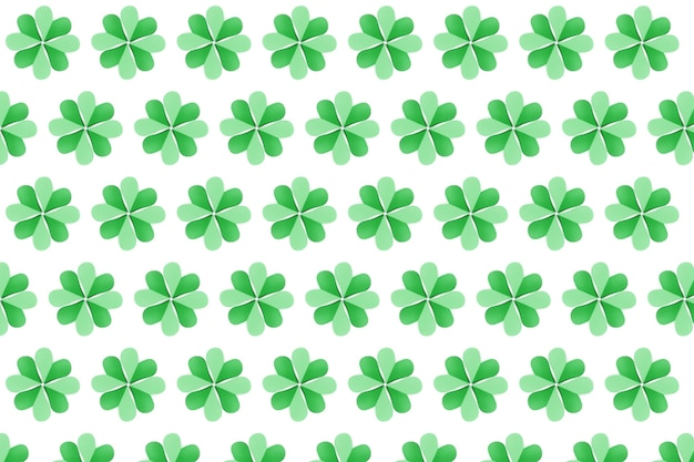 Handcraft shamrock's green plants pattern with four petals made from paper on a white wall. happy st.patrick 's day concept.