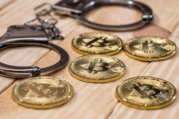 Handcuff and gold bitcoin. crime conception