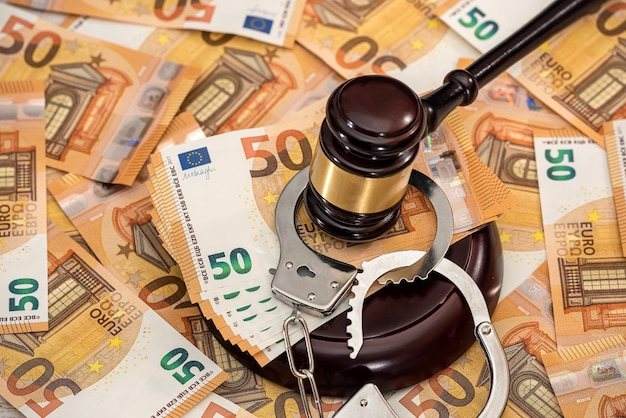 Handcuffs and euro banknotes
