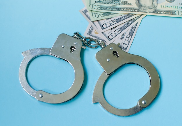 Handcuffs on money. the concept of a bribe