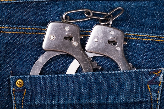 Handcuffs in pocket, arrest, violation of the law