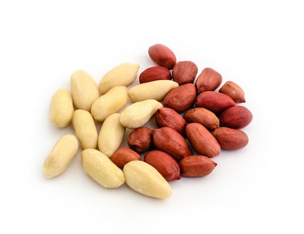 Handful of peanut peel kernels without peel on white