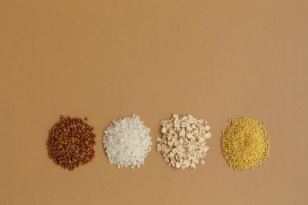 Handfuls of various cereals rice and oatmeal buckwheat and millet