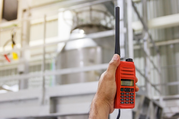 Handheld walkie talkie communication radio for communications at construction site