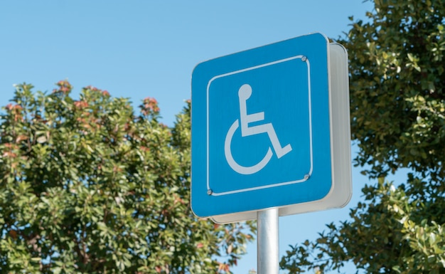 Handicapped icon on the ground of car parking area reserve for disabled people in urban gas station