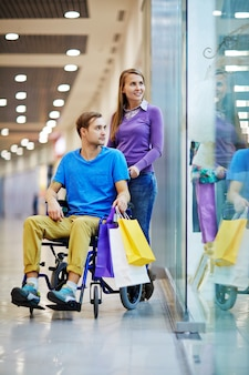 Handicapped man shopping