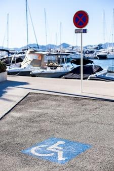 Handicapped parking spot, blue square on asphalt