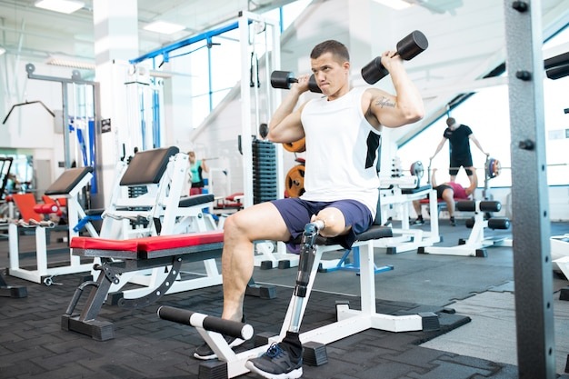 Handicapped sportsman training in gym