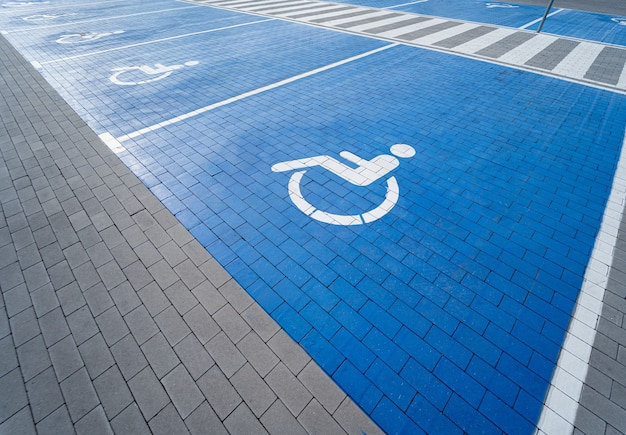 Handicapped symbol painted on a special parking space for disabled people