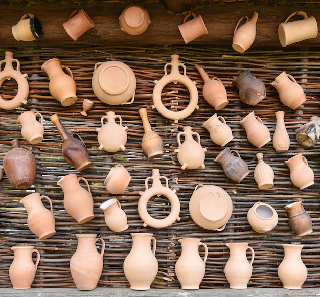 Handicraft clay products on birch wall