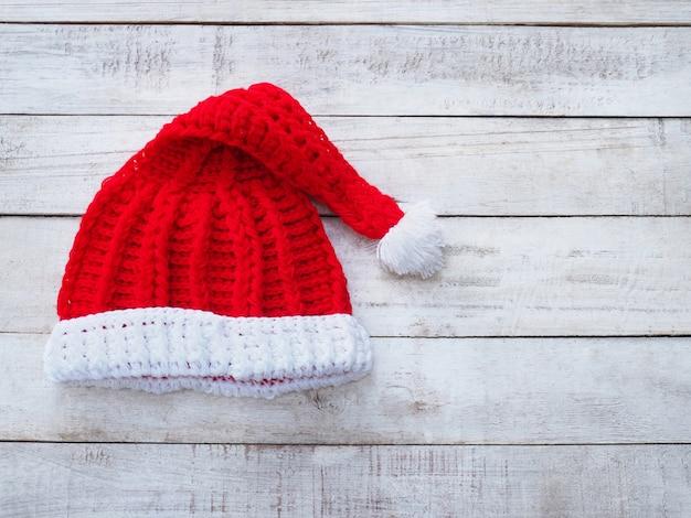 Handicraft santa claus hat on vintage wood