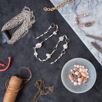 Handmade beads with spool yarn and beads on textured backdrop