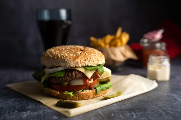 Handmade burger with fries with ketchup and coke